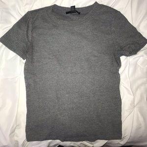 grey short sleeved